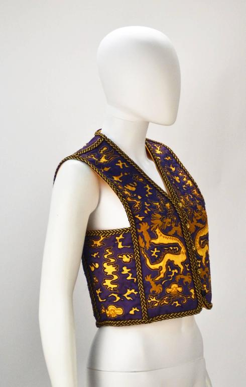 1960's Saint Laurent Rive Gauche purple and light orange Asian inspired with dragon pattern vest. He is known for his love of the dragon, Saint Laurent even owned a 1920's designed dragon chair.  Later designers of the YSL fashion house have paid