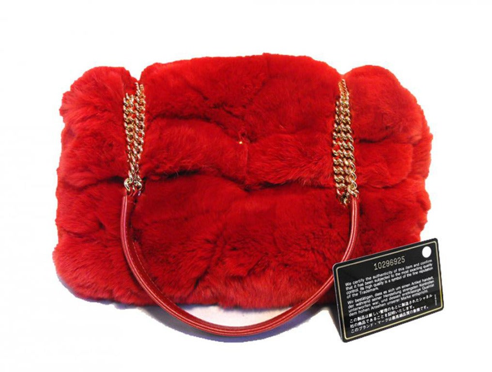 FABULOUS CHANEL red rabbit fur classic shoulder bag in excellent condition.  Bright red rabbit fur exterior trimmed with shining gold hardware and matching red leather.  Signature CC twist logo closure opens to a red leather lined interior that