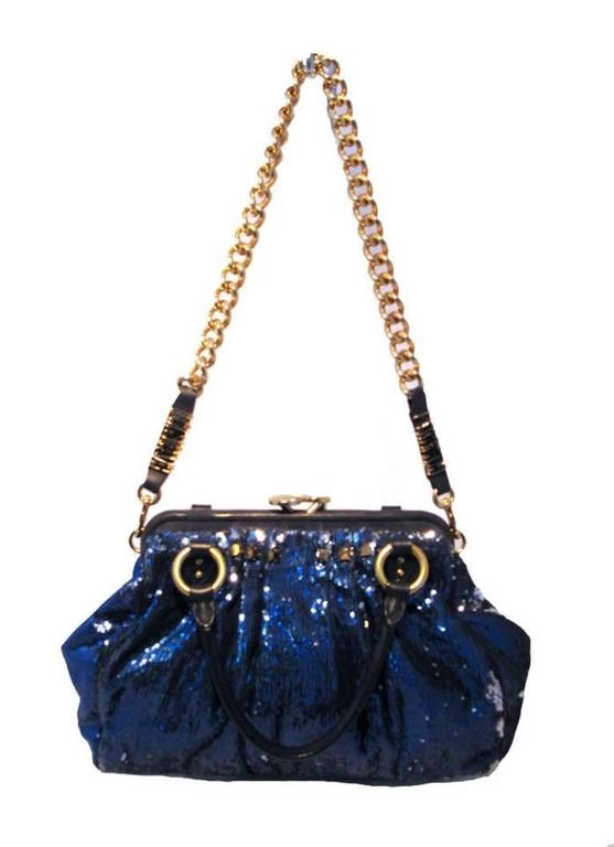 STUNNING MARC JACOBS New York Rocker Sequin Stam Bag in Very Good condition. Blue sequin exterior with black leather and gold hardware. Removable gold chain shoulder strap converts this piece between shoulder and hand styles easily. Oversized