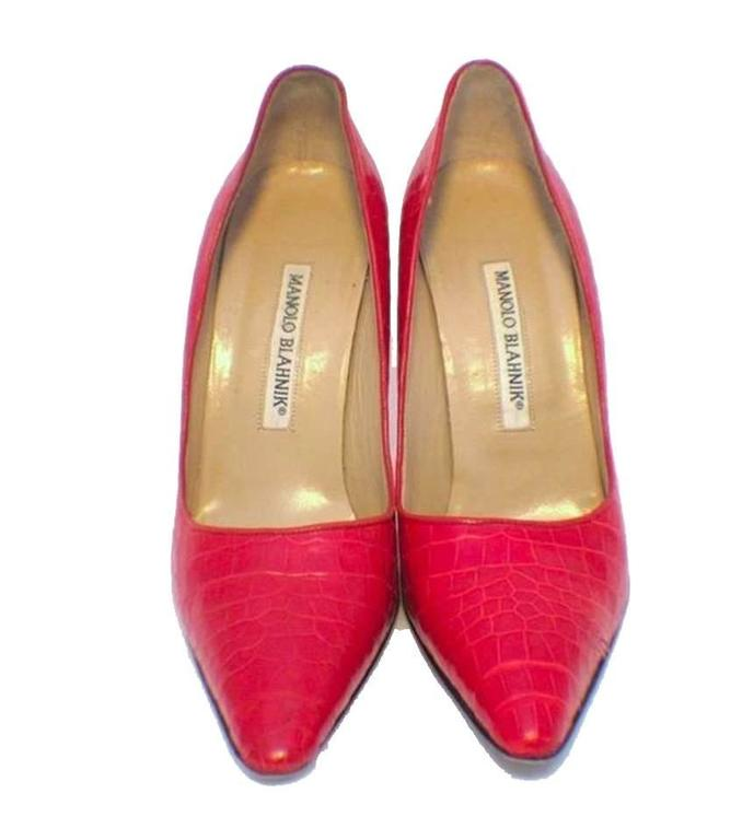 These fabulous Manolo Blahnik high heels are a must have for every fashionable wardrobe. Their timeless design makes them a versatile accessory that is sure to compliment many individual styles. The wonderful red alligator leather exterior is in