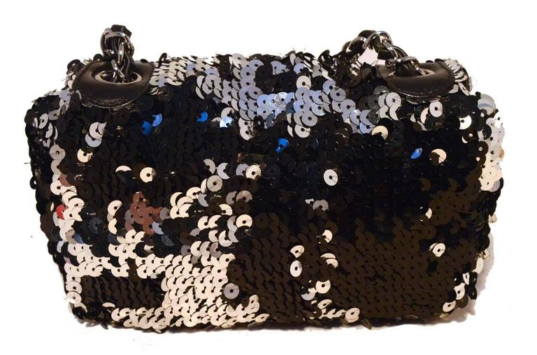 GORGEOUS Chanel sequin mini classic flap in excellent condition.  Black, silver, and grey sequin exterior trimmed with gunmetal hardware and woven chain and leather shoulder strap.  Front CC logo snap closure opens to a black satin and leather lined