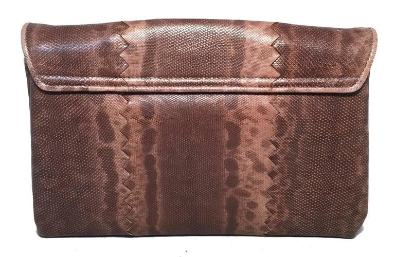 Gorgeous Bottega Veneta brown lizard leather clutch in excellent condition.  Brown lizard leather exterior with front twist closure.  Pleated expandable interior design features 2 seperate compartments, one with an additional zippered side pocket.