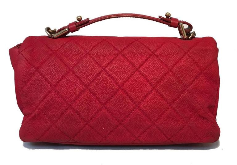 Beautiful Chanel red leather classic flap in excellent condition.  Red nubuck caviar leather exterior trimmed with bronze hardware.  Top handle and attached shoulder strap easily convert this piece between handbag and shoulder bag to suit your