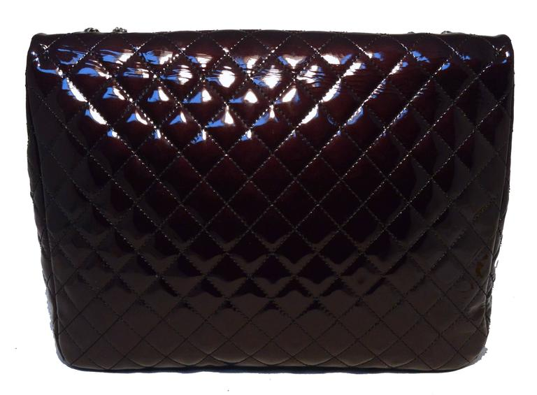 Gorgeous CHANEL patent leather classic flap in excellent condition.  Quilted patent leather exterior in deep purple/black trimmed with gunmetal hardware.  Front mademoiselle twist closure opens to a black leather and canvas lined interior that holds