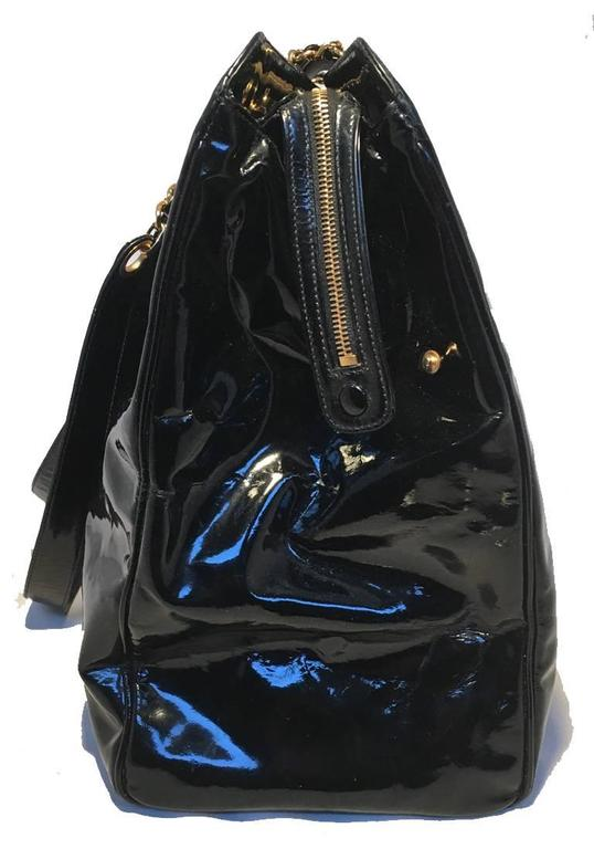 GORGEOUS Chanel patent leather model tote in excellent condition.  Black patent leather exterior with gold hardware and CC Chanel logo quilted on back.  Double leather and chain shoulder straps.  Front twist XL CC logo closure opens to 2 side