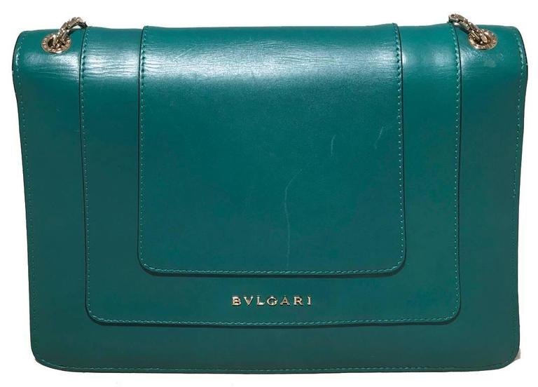 RARE Bulgari green leather shoulder bag in excellent condition.  Soft jade green leather exterior trimmed with double gold chain shoulder straps and a bejeweled snake head clasp closure.  Snake head clasp composed of black and white enamel with gold