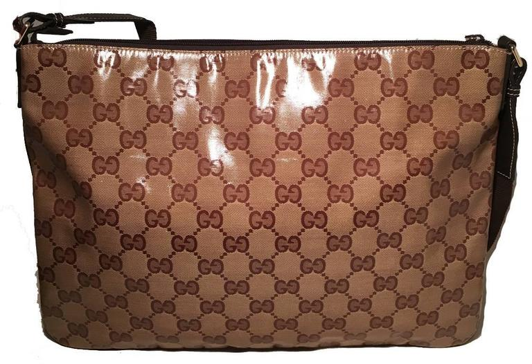 Timeless Gucci monogram messenger bag in excellent condition.  Coated monogram canvas exterior trimmed with brown leather and woven adjustable shoulder strap.  Top zipper closure opens to a brown nylon interior that holds ample storage space for