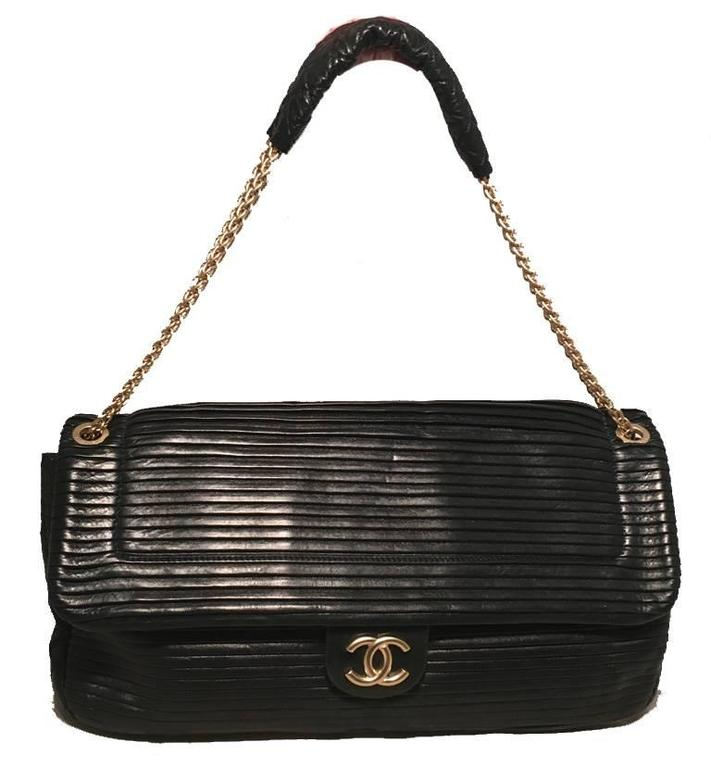 STUNNING Chanel black leather classic flap shoulder bag in excellent condition.  Pleated black leather upon top flap with diamond quilted leather throughout. gold chain shoulder strap and leather shoulder protector.  Snap front Logo closure opens to