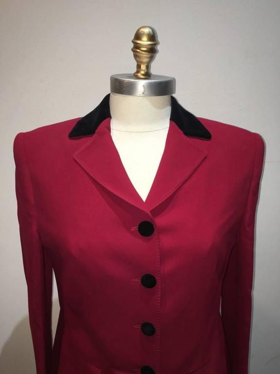 GORGEOUS Vintage Moschino black and red blazer in excellent condition.  Red body with black velvet collar and buttons.  Long sleeve style with 2 flap pockets upon hips.  4 button front closure. Red silk lining. Original tags intact.  Made in Italy.