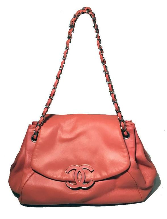 GORGEOUS Chanel coral leather top flap shoulder bag in excellent condition.  Coral leather lambskin leather exterior trimmed with silver hardware.  Signature woven chain and leather shoulder straps. Front CC leather logo lifting closure opens to a