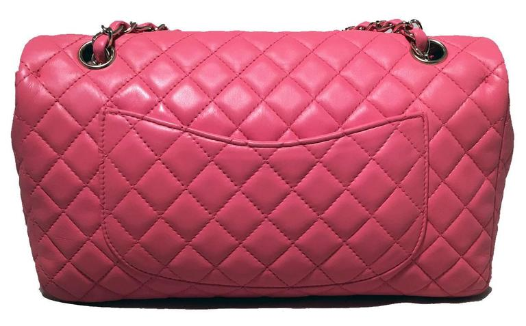 GOREGOUS Chanel pink charms classic flap shoulder bag in excellent condition.  Quilted pink lambskin leather exterior trimmed with silver hardware.  6 unique heart shaped charms along shoulder strap.  CC logo twist closure opens via single flap to