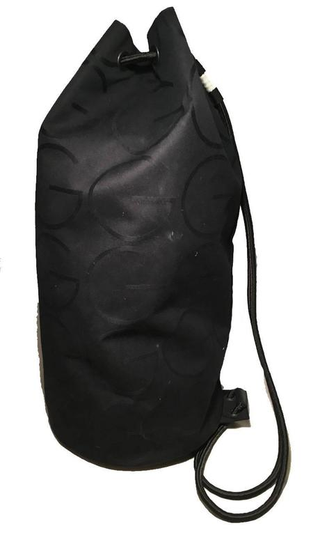 RARE Gucci Black Canvas Sling Backpack Bag In Excellent Condition For Sale In Philadelphia, PA