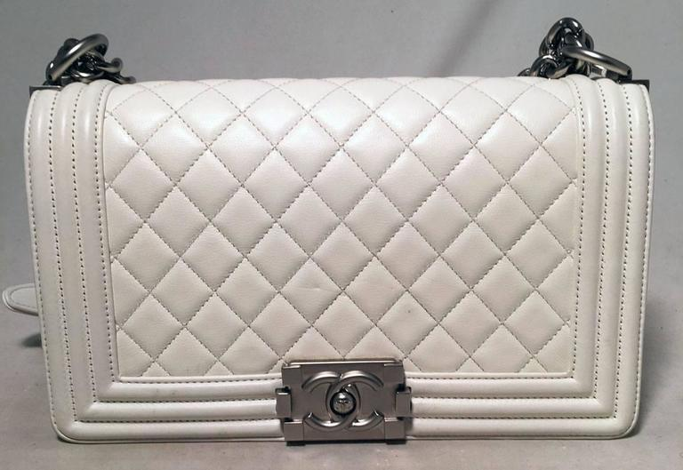 GORGEOUS Chanel White leather Le Boy bag in excellent condition.  White lambskin leather exterior trimmed with gunmetal hardware.  Heavy chain and leather shoulder strap can be worn short or long to suit any style.  Front pinch latch logo closure