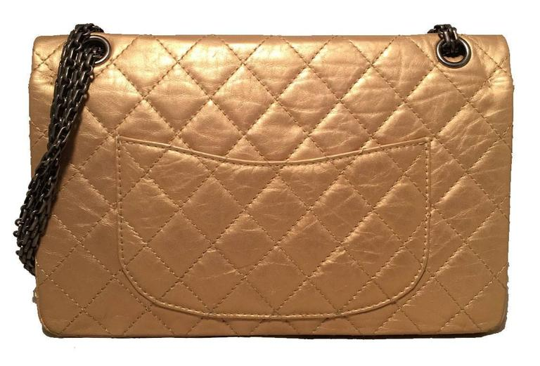 GORGEOUS Limited edition Chanel gold 2.55 reissue 226 double flap classic in excellent condition.  Quilted distressed gold leather exterior trimmed with gunmetal hardware.  Mademoiselle style twist closure opens to a gold and beige leather lined
