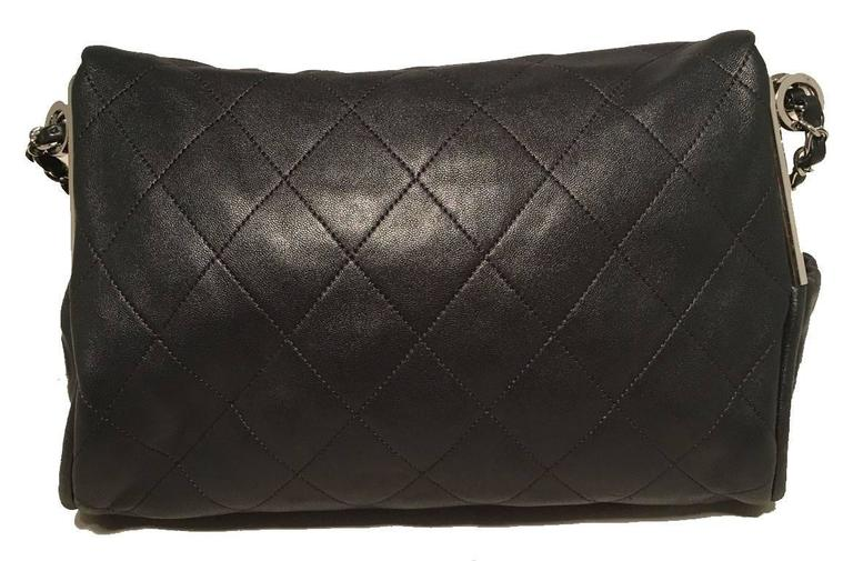 STUNNING Chanel black leather fold over top flap shoulder bag in excellent condition.  Quilted black leather exterior trimmed with shining silver hardware, woven chain and leather shoulder strap and a CC logo charm zipper pull.  2 exterior side
