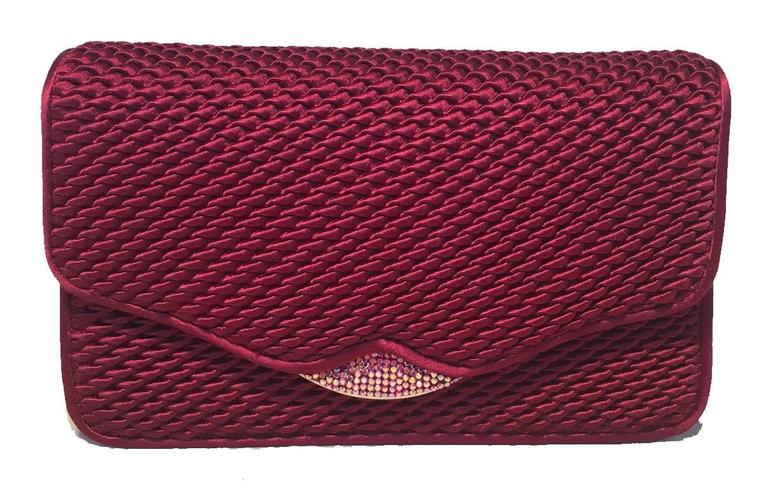 GORGEOUS Judith Leiber vintage satin and swarovski crystal evening bag clutch in excellent condition.  Dark red pinched textured style satin silk exterior trimmed with gold and silver hardware and swarovski crystal details. Front flap snap closure