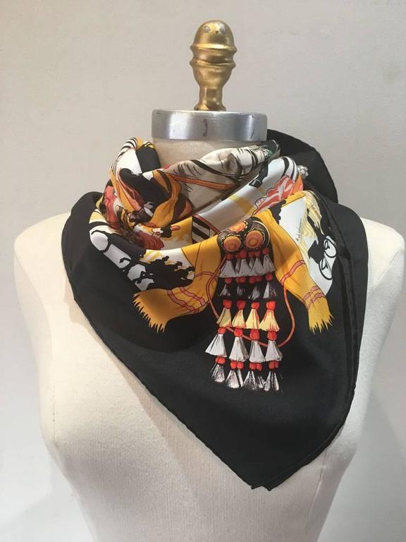 GORGEOUS Hermes Feria de Sevilla silk scarf in black in excellent condition.  Original silk screen design c1996 by Hubert de Watrigant features the festive native cowboys and decor of the annual Sevilla fair.  Rare black colorway. 100% silk, hand