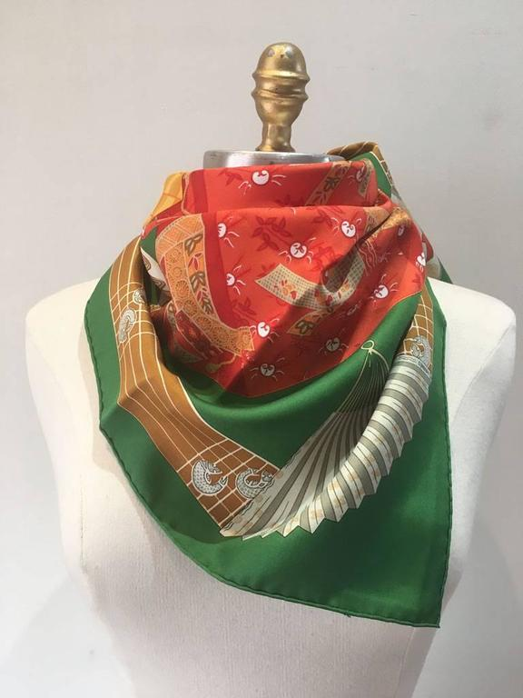 BEAUTIFUL Hermes vintage Kimonos et Intros silk scarf in green in excellent condition.  Original silk screen design c1986 by Annie Faivre features the traditional japanese kimono dress pieces in a variety of colors over a green background.  100%