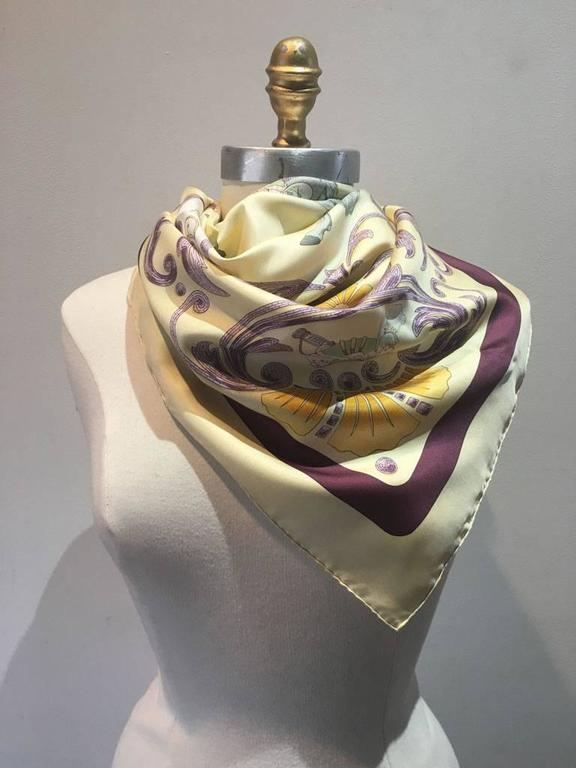 Beautiful Vintage Cheval Turc silk scarf in excellent condition.  Original silk screen design circa 1969 by Christiane Vauzelles features a gorgeous centered horse design with an ornate purple detailed border over a beige background with a beige and