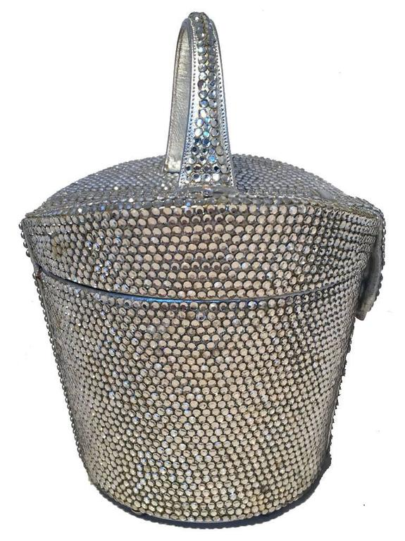 STUNNING Judith leiber Swarobvskli crystal basket evening bag in very good vintage condition.  Silver swarovski crystal exterior in unique basket shape perfect for any special occasion.  Front snap closure opens to a silver silk lined interior.  No