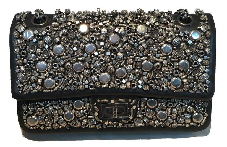 GORGEOUS Chanel studded leather double flap classic.  Black leather exterior with unique silver studded beads around all sides.  Mademoiselle style twist closure opens via double flap to a black leather lined interior that holds 3 slit, 1 lipstick,