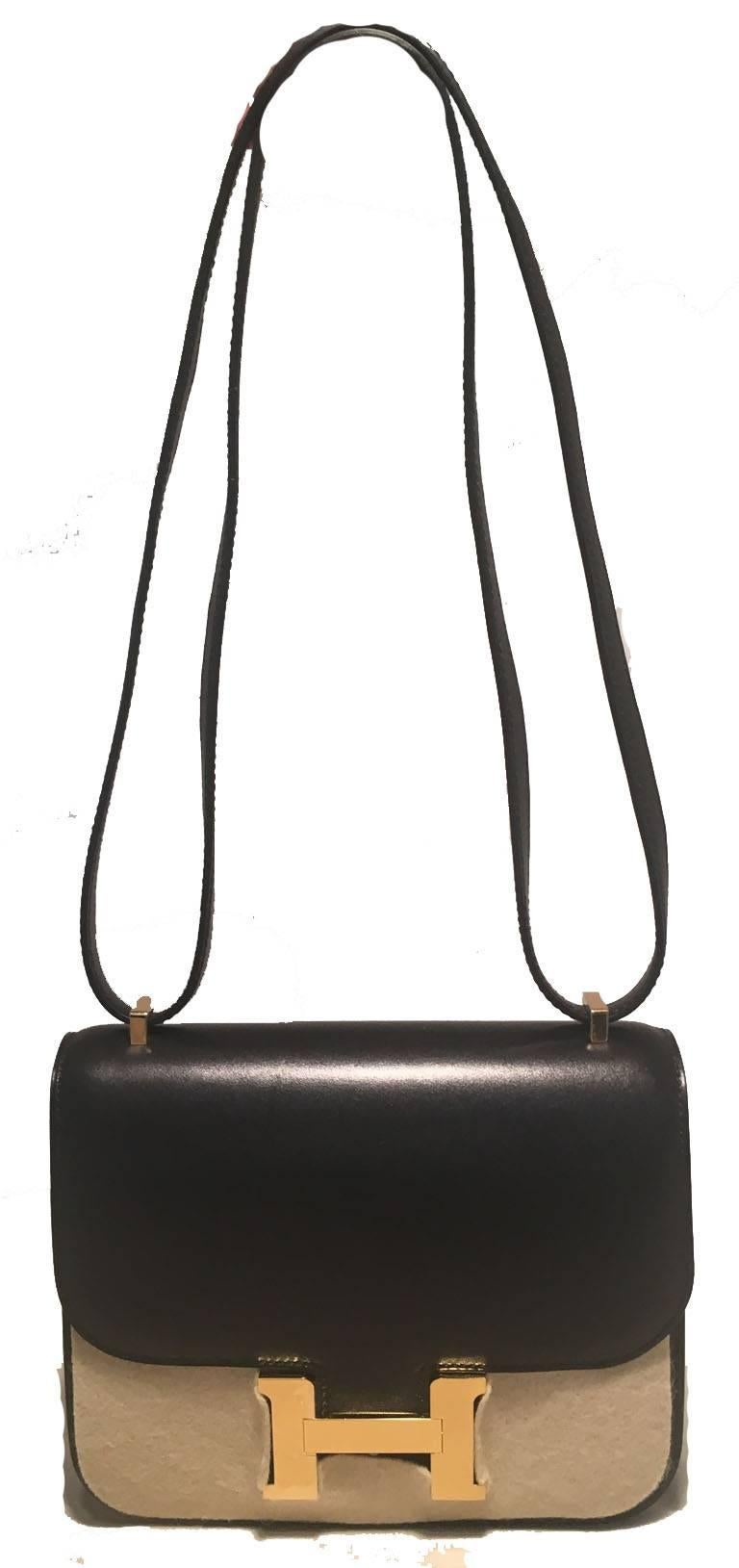 NWOT Hermes 18cm constance shoulder bag in NEW unused condition.  Black box calf leather body with shining gold hardware.  Front H logo magnetic flap closure opens to a black kidskin lined interior that holds 2 separate storage compartments and a
