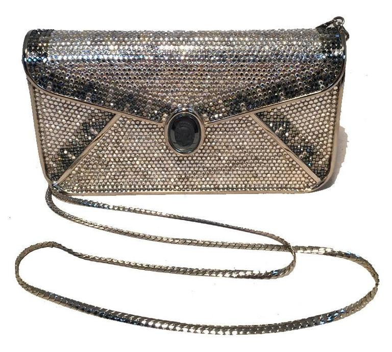 BEAUTIFUL Vintage Judith Leiber Swarovski crystal minaudiere clutch in very good condition.  Silver and gray swarovski crystal exterior trimmed with silver hardware and front gray roman soldier cameo detail along front flap closure.  Silver leather