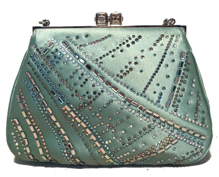 BEAUTIFUL Judith Leiber silk and swarovski crystal mini evening bag in excellent condition.  Teal silk exterior trimmed with multicolored swarovski crystals and silver hardware.  Top crystal kiss lock closure opens to a teal silk lined interior that