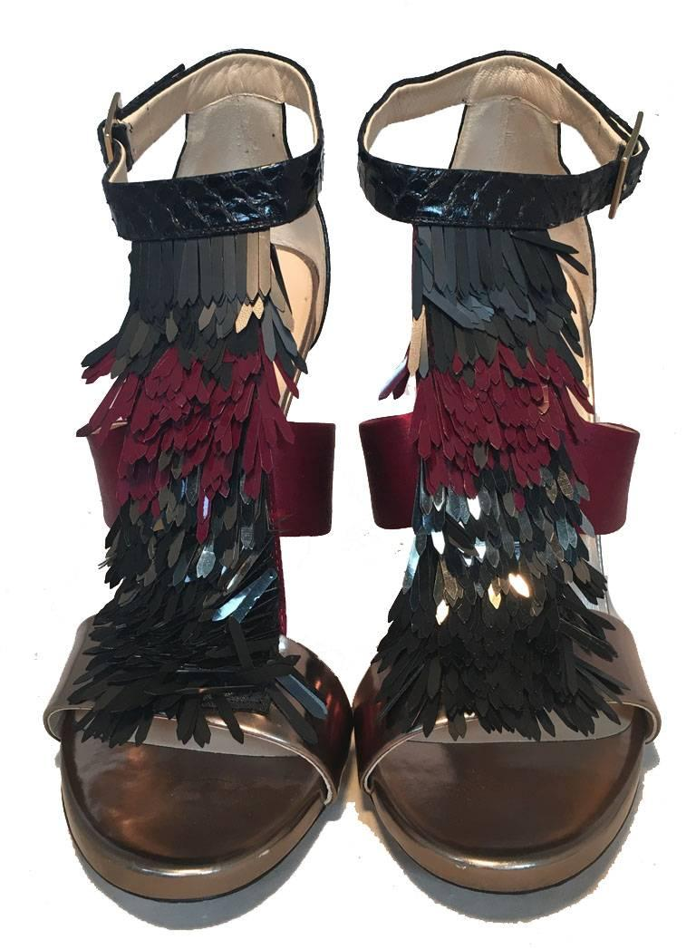 BEAUTIFUL Jimmy Choo fringe trim high heels in excellent condition.  Black snakeskin, purple satin, and gunmetal leather strap style body and heel with a matching black, gunmetal, and purple fringe tassel detail along the front side.  Angle strap