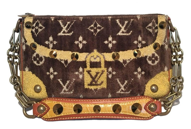 AMAZING Limited Edition Louis Vuitton monogram velvet trompe l'oeil pochette in excellent condition.  Velvet monogram exterior trimmed with leather piping along edges, gold hardware, alligator leather handle, and bronze chain handle strap.  Top