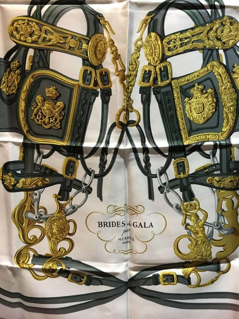 Gorgeous Vintage Hermes brides de gala silk scarf in excellent condition. Original silk screen design c1950s. 100% silk, hand rolled hem. made in france. no tag. excellent vintage condition, no stains, smells, or fabric pulls. Perfect for vintage