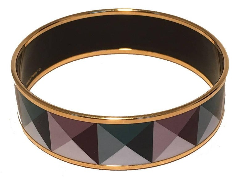GORGEOUS Hermes geo print gold enamel bracelet bangle in excellent condition.  Various teals and purples in a geometric print throughout.  Gold hardware trim. Made in France stamped O.  No scuffs or major scratches.  Original Box included. Measures