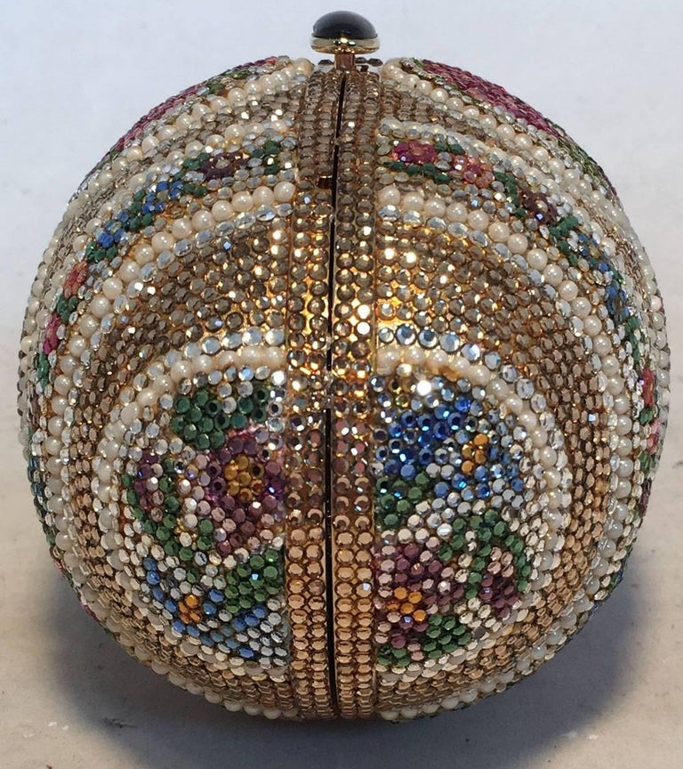 GORGEOUS Judith Leiber swarovski crystal egg minaudiere in excellent condition. Multicolor swarovski crystal design with delicate pearl details.  Button closure opens to a gold leather interior with separate compartments and attached gold chain