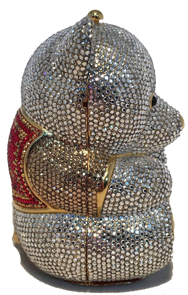 ADORABLE Judith Leiber teddy bear minaudiere in excellent condition. Clear swarovski crystal exterior with red crystals on vest, Black semi precious stone eyes and gold form body throughout. Gold leather base. Top button closure opens to a gold