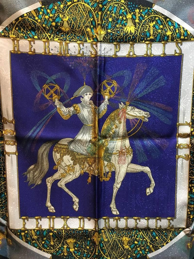 GORGEOUS Vintage Hermes Feux D'artifice silk scarf in excellent condition.  Original silk screen design c1987 by Michel Duchene features a centered horse design with renaissance style rider centered in a square and circle thats surrounded by cosmic