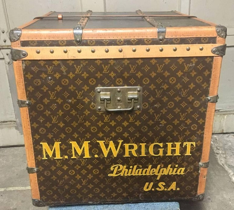 GORGEOUS Louis Vuitton monogram cube trunk in excellent condition. Monogram canvas exterior trimmed with wood and brass hardware. Top triple latch closure opens to a beige canvas lined interior that holds one storage shelf and one larger storage