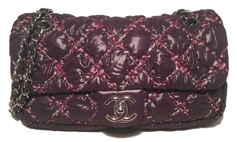 RARE Chanel Plum Nylon Quilted Puffy Classic Flap Shoulder Bag in excellent condition.  Dark plum purple nylon exterior quilted with a unique thick threaded pink and maroon topstitching all trimmed with silver hardware.  Front CC logo twist closure