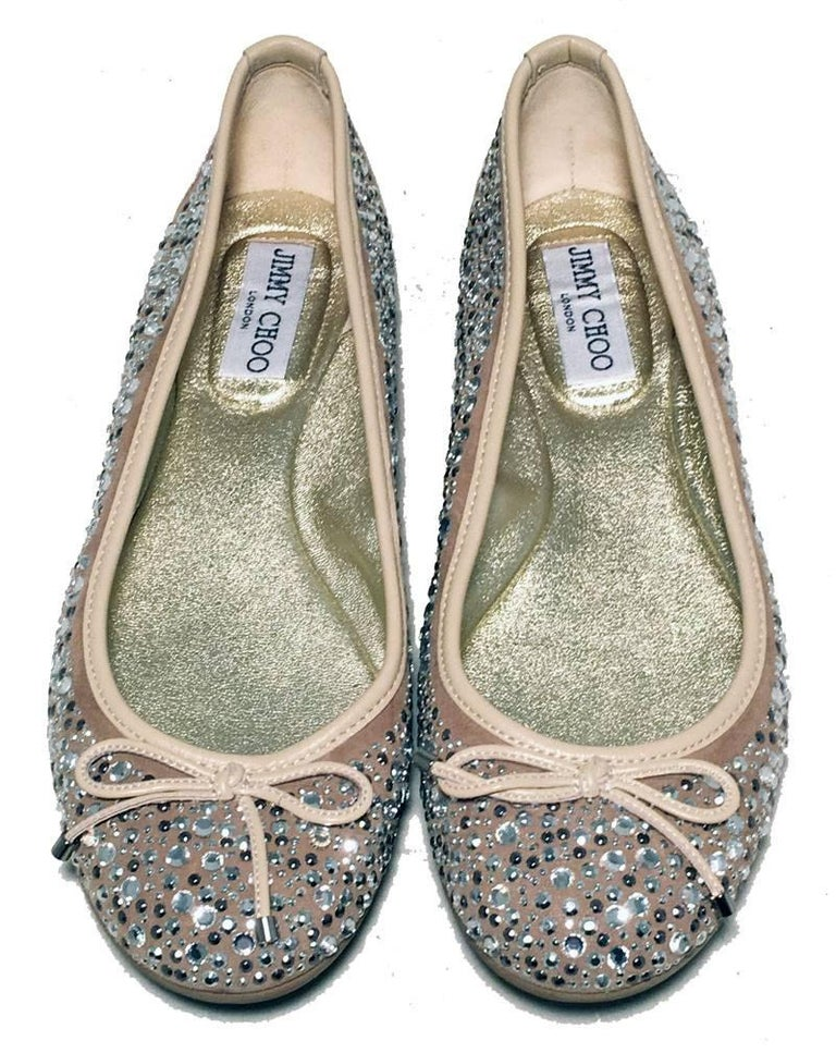 Jimmy Choo Nude and Gold Crystal Studded Ballet Flats Size 37.5 in excellent condition.  Nude leather upper with silver crystal and gunmetal stud details.  Gold leather insole.  Black and tan branded Jimmy choo rubber soles with very light wear.
