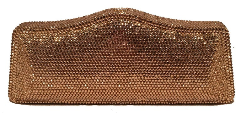 Judith Leiber Gold Swarovski Crystal Evening Bag Minaudiere Clutch in excellent condition.  Gold swarovski crystal exterior trimmed with a top button closure that opens to a gold leather lined interior.  Removable gold chain shoulder strap attached