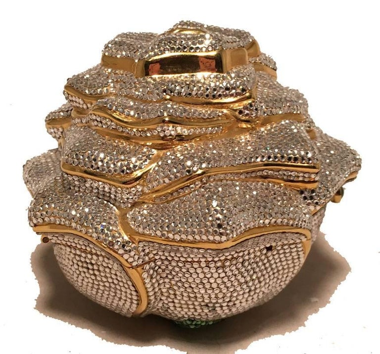 Judith Leiber Swarovski Crystal Rose Minaudiere Evening Bag in excellent condition.  Clear swarovski crystals with gold metal trim.  front button closure opens to a gold leather lined interior.  No stains, smells or missing crystals.  Perfect for