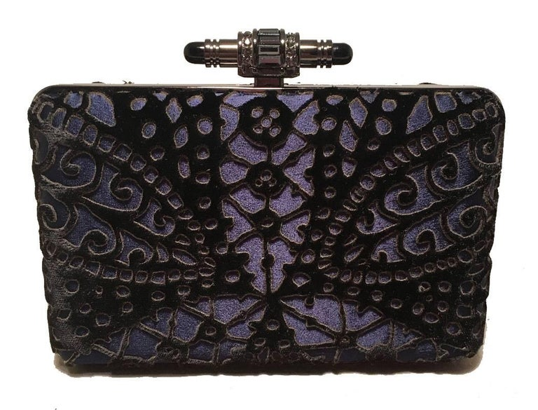 Stunning Judith Leiber Navy Blue Black Velvet Cut Out Evening Bag Clutch in excellent condition.  Navy blue body with black velvet lazer cut overlay in beautiful abstract pattern throughout.  Top lifting closure opens to a silver leather interior