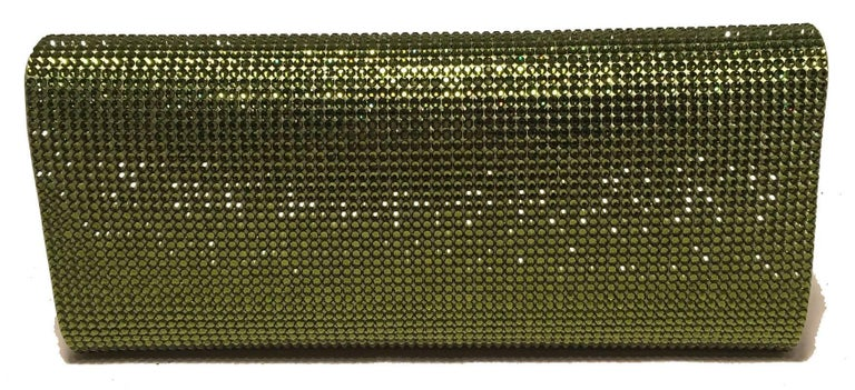 GORGEOUS Judith Leiber Green Crystal Evening Bag Clutch in excellent condition.  Green crystal exterior in classic envelope rectangle shape.  Front flap snap closure opens to green and purple silk lined interior that holds a silver chain handle and