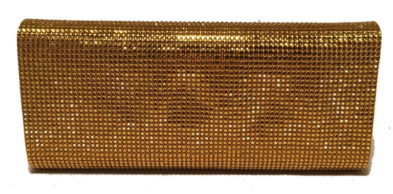 GORGEOUS Judith Leiber Gold Crystal Evening Bag Clutch in excellent condition.  Gold crystal exterior in classic envelope rectangle shape.  Front flap snap closure opens to yellow gold and purple silk lined interior that holds a silver chain handle