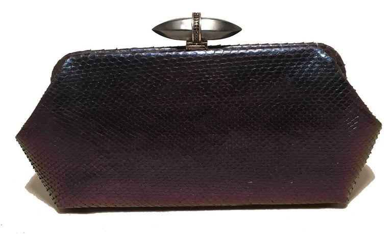 Judith Leiber Purple Blue Snakeskin Python Iridescent Clutch in excellent condition.  blue purple iridescent python snakeskin exterior trimmed with gunmetal hardware.  Top lift closure opens to a purple silk interior that holds an attached chain