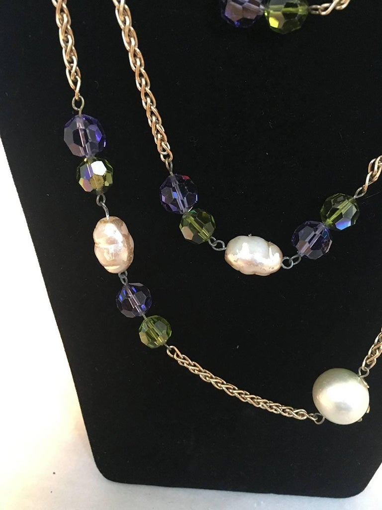 STUNNING Chanel Vintage Gold Necklace with Large Pearls & Green and Purple Crystal Beads in good condition. Gold link chain necklace with large round pearl beads that feature matte gold CC logos and purple and green crystal cut beads. Wear
