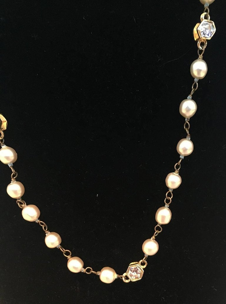 Classic Chanel Vintage Pearl and Small Crystal Beaded Necklace in very good condition. Round pearl beads with small gold hexagon shape beads with centered crystals on 2 sides. Crystal hexagons every 6 pearls. Spring ring closure. Engraved logo charm