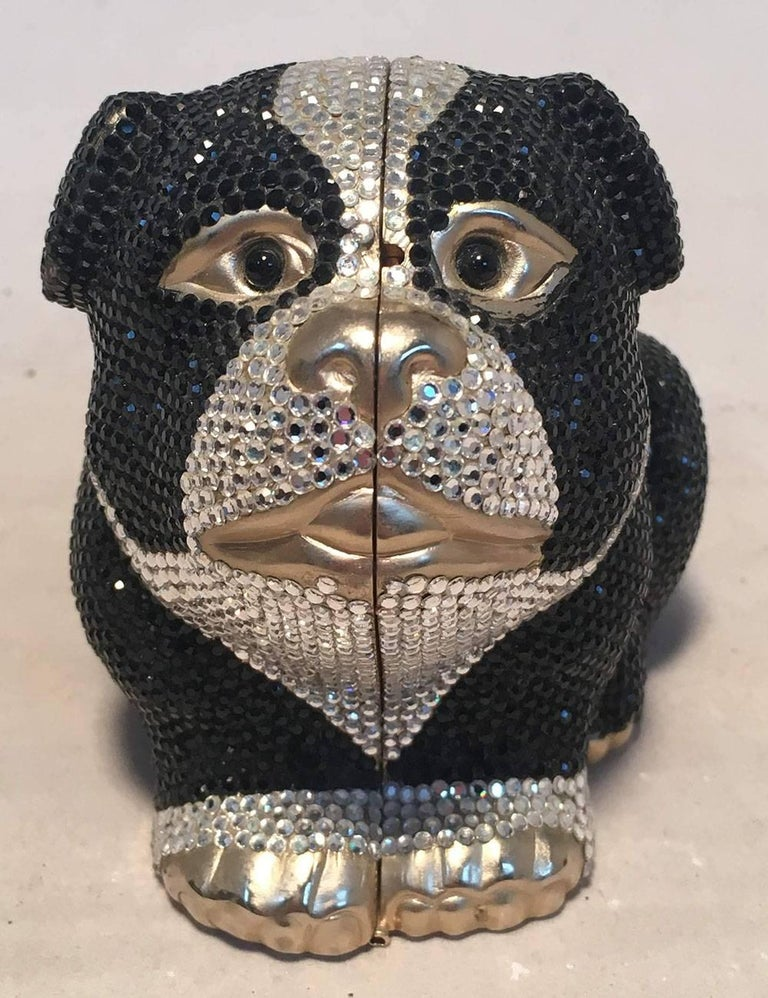 BEAUTIFUL Judith Leiber Swarovski Crystal bulldog minaudiere evening bag in excellent condition.  Black and silver Swarovski crystal exterior with gold bulldog shaped body. Top button closure opens to a gold leather lined interior with 2 separate