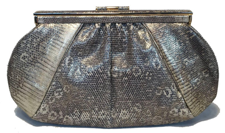 STUNNING Judith Leiber Gold and Natural Gray Ring Lizard Clutch in excellent condition.  Natural gray and white ring lizard leather exterior with gold sheen throughout and gold hardware trim. Top lifting hinge closure opens to a beige silk lined