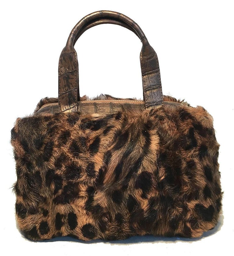 FABULOUS Nancy Gonzalez Leopard Print Fur and Crocodile Baguette in excellent condition.  Brown leopard print fur body with bronze crocodile leather trim. Double top handles for easy carrying. 3 top zipper closures reveal 2 side exterior pockets and