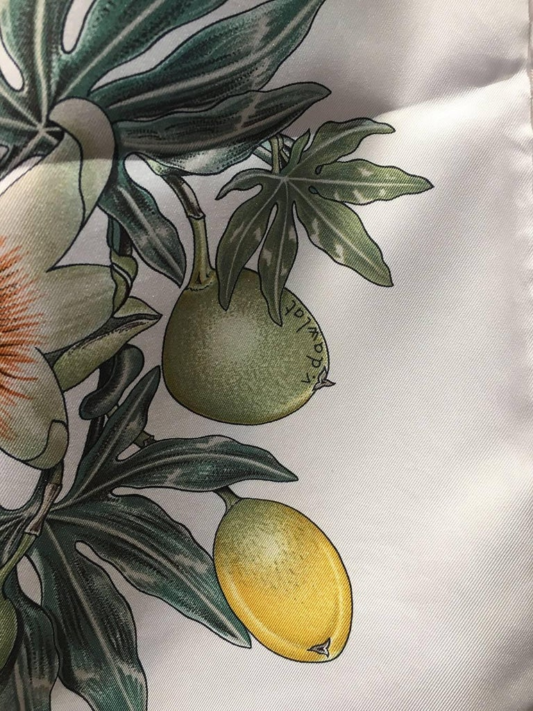GORGEOUS Hermes Passiflores Silk Scarf c1996 in Cream in excellent condition.  Original silk screen design c1996 by Valerie Dawlat-Dumoulin features a centered star design in tan surrounded by green foliage with lemon and lime fruits, a basket with